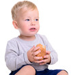 baby eats bread