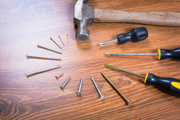 Set of tools over a wooden panel