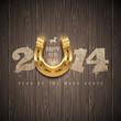 New 2014 year - holidays design with golden horseshoe