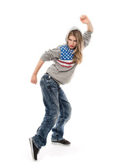 Beautiful female hip hop dancer in a dancing pose, isolated