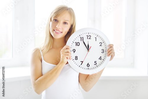 smiling girl with wall clock
