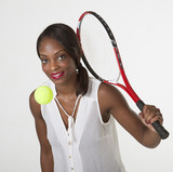 Young black woman playing tennis