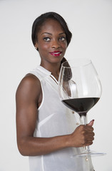 Woman holding very large glass of red wine