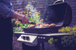 Man cooking meat on barbecue - 56473790