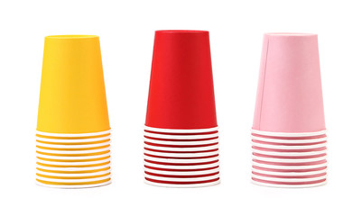 Three different color cups in a row.