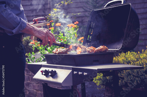 Foto op Canvas Grill / Barbecue Man cooking meat on barbecue