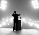 businessman standing on podium