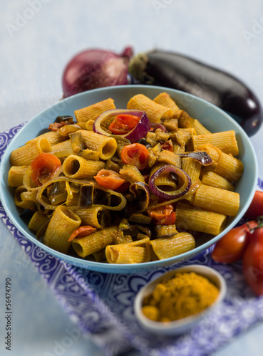 pasta with eggplants  tomatoes and curry, selective focus