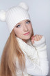 Portrait of beautiful young girl wearing winter clothing studio