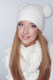 Portrait of beautiful young happy girl wearing winter clothing s