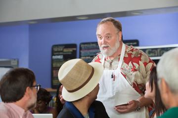Cafe Employee Helping Customers