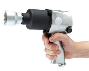 the hand holds air impact wrench