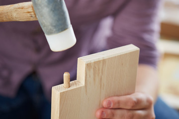 Hands assembling piece of furniture