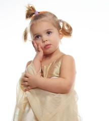 Thoughtful little girl in golden dress