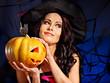 Witch holding pumpkin