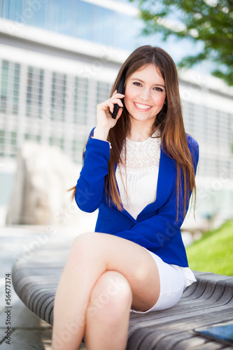 Portrait of an attractive woman talking on the phone