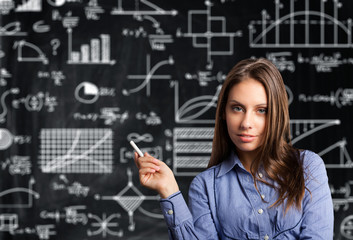 Woman in front of a blackboard