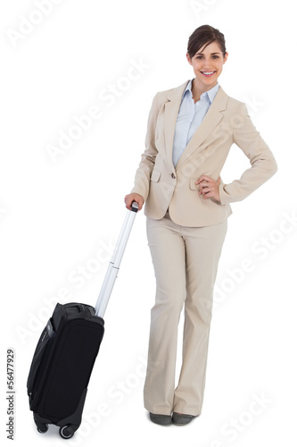 Happy businesswoman with suitcase