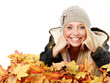 Woman has fun with leaves in autumn