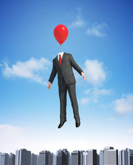 Balloon man floating above a city