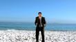 Free businessman dancing on the beach