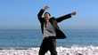 Free happy businessman dancing on the beach