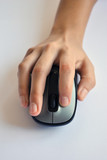 Woman's hand on wireless mouse