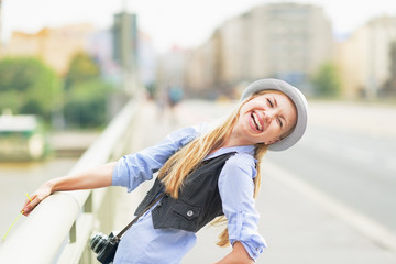 Happy hipster girl on city street