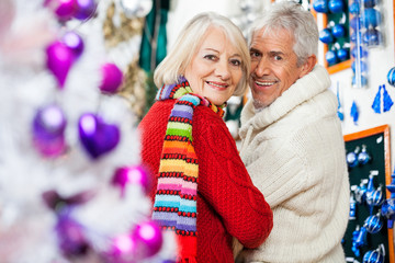 Happy Senior Couple At Christmas Store