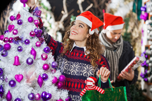 Woman Shopping For Christmas Decorations