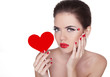 Beautiful woman with glamour bright makeup holding red heart iso