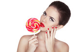 Fashion makeup. Beauty Girl Portrait holding Colorful lollipop.