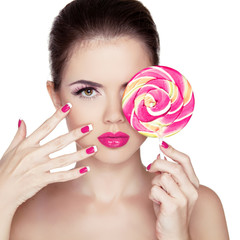 Beauty Girl Portrait holding Colorful lollipop. Fashion makeup.