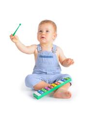 Cheerful baby boy and xylophone