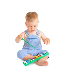 Cheerful baby boy and xylophone