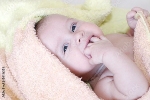 baby age of 4 months in towel after bath