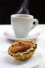 Cake with nuts and cup of coffee