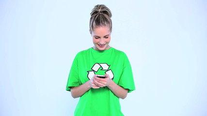 Attractive woman wearing t-shirt with recycling symbol