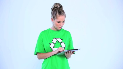 Doubtful environmental activist using a digital tablet