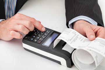 Hands with cash register
