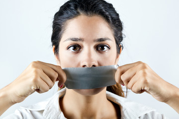 Woman with mouth covered with tape.