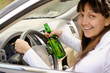 Female driver drinking and driving