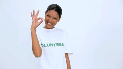 Volunteer woman does sign at camera