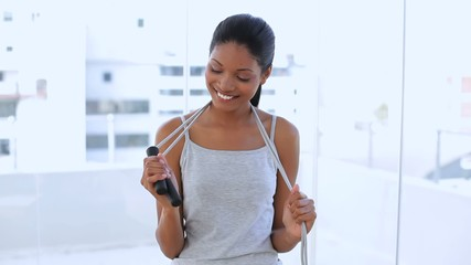 Beautiful woman with her jump rope