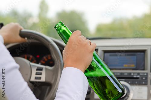Alcoholic female driving a car