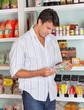 Man Choosing Product In Store