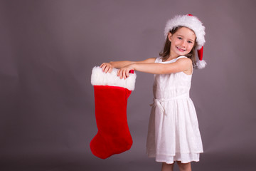 Little girl and her Christmas stocking