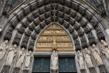 Details of stone figures on the facade of Cologne cathedral