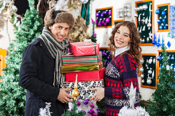 Happy Senior Couple Shopping In Christmas Store