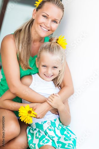 Family portrait cute little girl and cheerful mom